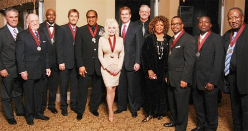 (L-R): Steve Brallier, executive director of GMA Foundation; Inductee Lari Goss; Inductee Lyndon Baines Jones of Dixie Hummingbirds; Inductee Michael W. Smith; Inductee Dr. Bobby Jones; Inductee Dolly Parton; Ed Harper, chairman of the GMA Foundation Board; John W. Styll, president and CEO of GMA; Inductees Dixie Hummingbirds Sundray Tucker (daughter of deceased Ira Tucker), Carlton Lewis, William Bright and Torrey Nettles. Photo: Aaron Crisler