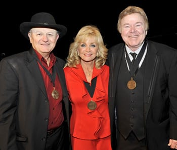 (L-R): Charlie McCoy, Barbara Mandrell and Roy Clark. Photo: Donn Jones