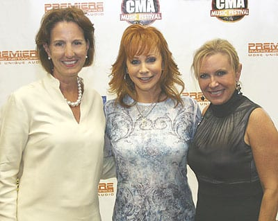 (L-R): Julie Talbott, Exec. VP of Affiliate Marketing, Premiere Radio Networks; Reba McEntire; Tammy Genovese, Chief Executive Officer, CMA