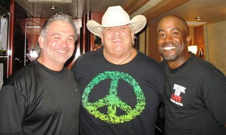 "While in Tampa, FL recently for a stop on Rascal Flatt's ""Unstoppable"" tour, Darius Rucker got the chance to meet one of his heroes, semi-retired professional wrestler Dusty Rhodes - better known as ""The American Dream."" Rhodes is a HUGE country music fan and was thrilled to get to meet Darius.   Pictured L-R: Mike Culotta (WQYK PD), Rhodes & Rucker"
