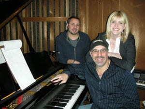 Pictured l to r standing: Producer Lex Lipsitz, Emma Jacob Seated: Jimmy Nichols, producer/president Black River Music Group