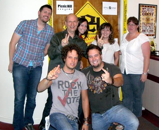 (Back L-R) MR Chart Mgr. Jon Freeman, Boss Ross, RowFax Mgr. Michelle Ross, News Editor Sarah Skates, Art Dir. Christie King;