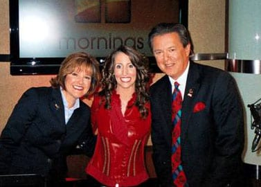 "Laura Bryna appeared on FamilyNet's ""Mornings with Lorri and Larry"" show (in 15 million households nationwide) on Thursday July 9th where she performed her song ""Hometown Heroes"" and spoke with Lorri and Larry and unveiled the new cover of Southern Beauty Magazine which Laura adorns, and spoke with the new artist about her involvement with the Air Guard and their Media Campaign as well as Bryna's work with the Make-A-Wish Foundation.  Lorri Allen, Laura Bryna and Larry Estepa on ""Mornings"""