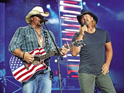 "Trace Adkins is supporting Toby Keith on his current ""America's Toughest Tour."" But nothing could have prepared the two for the reaction they've been getting when Toby brings Trace back out on stage for an encore performance of Keith's monster hit ""Courtesy of the Red, White & Blue (The Angry America)."" The natural connection between the two artists is obvious to the crowds and, in retrospect, to Toby as well. Keith has been bringing Adkins out for the explosive performance each night of the tour, which started in June and runs through September."