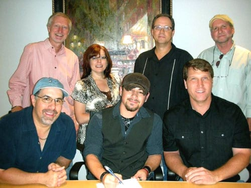 Pictured l to r seated: Jimmy Nichols, president, BRMG, Ty Williams, Gratton Stephens, president/ceo Cherry Heart Music  Standing: Rick Baumgartner, vp/gm BRMG, Tonya Ginnetti, vp/director of artist relations, BRMG, Shelby Kennedy, svp/coo, Cherry Heart Music & co-producer and James Hudson, co-producer.