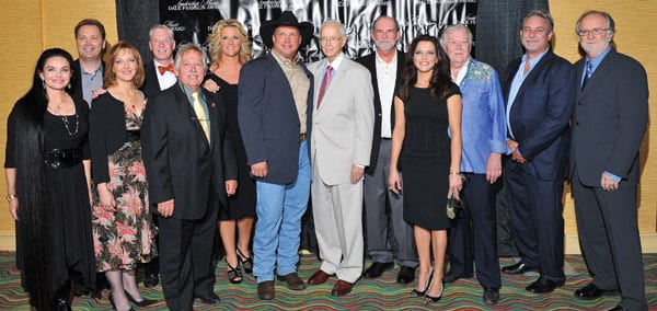 Honorary Chairs Crystal Gayle and Steve Wariner, Leadership Music executive director Kira Florita, Leadership Music board president Pat Collins, tribute performer John Conlee, Honorary Chair Trisha Yearwood, Garth Brooks, Jim Foglesong, Allen Reynolds, tribute performer Martina McBride, Honorary Chair Cowboy Jack Clement, speaker John McBride, and LMDFA tribute show producer Garth Fundis.   Photo credit:  Steve Lowry
