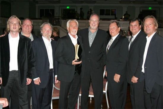 Kenny Rogers celebrates after receiving the Cliffie Stone Pioneer Award. (L-R) Dreamcatcher's Jason Henke, Webster PR's Kirt Webster, Dreamcatcher's Bob Burwell, Kenny Rogers, Capitol Records Mike Dungan, Dreamcatcher's Jim Mazza, lawyer Bruce Phillips, and Dreamcatcher's Kelly Junkerman.
