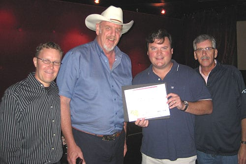 Aleep At The Wheel was honored at this year's Americana Awards for Lifetime Achievement in Performance.  At a recent celebration of the award, the CMA also presented them with a plaque in recognition of 40 years of furthering country music.  Pictured L-R:  Business Manager Peter Schwarz, Asleep At The Wheel's Ray Benson, CMA's Hank Adam Locklin and ASCAP's Herky Williams.
