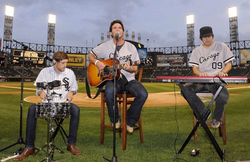 (L-R): Erich Wigdahl, Nail, and Eric Kinney perform for before the White Sox game. Photo: Ron Vesely