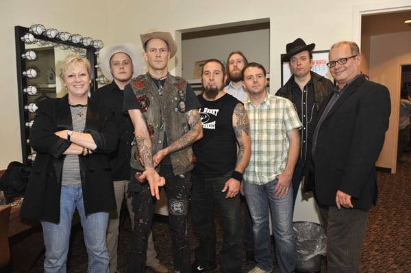 Pictured L-R—Exhibit co-curator Carolyn Tate, Daniel Mason (banjo), Williams, Shawn McWilliams (drums), Zach Shedd (bass), Adam McOwen (fiddle), Andy Gibson (steel guitar, dobro) and exhibit co-curator Michael McCall. Photo by Donn Jones