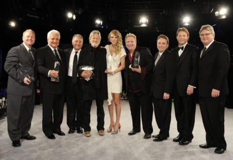 The night's big winners at the 2009 BMI Country Awards in Nashville. (L-R): Troy Tomlinson, Pres./CEO Sony ATV Music Publishing Nashville; Martin Bandier, Chairman/CEO, Sony/ATV Music Publishing LLC; Del Bryant, BMI Pres./CEO; 2009 BMI Icon Kris Kristofferson; Song of the Year honoree Taylor Swift; Songwriter of the Year Bobby Pinson; Jody Williams, BMI VP Writer/Publisher Relations Nashville; Clay Bradley, BMI Asst. VP Writer/Publisher Relations Nashville; and Phil Graham, BMI Sr. VP Writer/Publisher Relations. Photo: John Russell