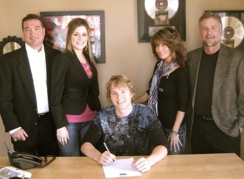 Kroll has had a single on Sean Patrick McGraw, performed on Jimmy Kimmel and on CMT & GAC. Pictured (L-R) Back: Owner Daniel Wood, staff writer Blake Gray, Creative Director Holly Nance, Owner Danny Pool, Seated: Kroll.