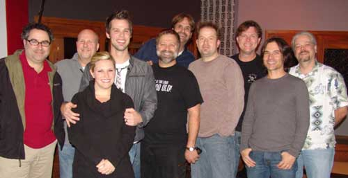 Daywind Records' artist, Aaron and Amanda Crabb, were recently at Nashville's Sound Shop recording a brand new album. The album is being produced by Michael Sykes and can be expected to hit stores this spring. Pictured (L-R): Michael Turner, Gary Prim, Amanda Crabb, Aaron Crabb, Michael Sykes, Norman Holland, John Willis, Jeff King, Steve Brewster, and engineer.