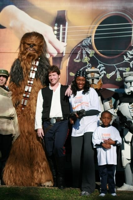 Taj and Eriq George with Star Wars Characters at the Dunkin' Donuts Family