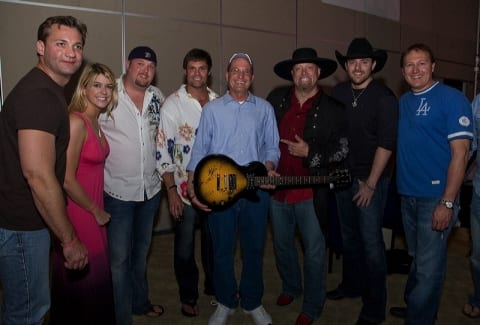 Pictured  (L-R) Wade Hayes, Jamie Fox Hardwick, Shane Thomas, Troy Gentry, Auction winner Mike Kimlerling, Eddie Montgomery, Chris Young and Tim Nichols. Photo by Joe Hardwick