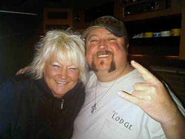 Colt Ford, while on tour with Larry The Cable Guy in the Pacific Northwest, stopped by country station KKWF in Seattle, WA on Friday, December 4. Colt spent over two hours on-air with Lola. Pictured: Colt Ford (R) with MD Lola Montgomery (L) at 100.7 The Wolf in Seattle.