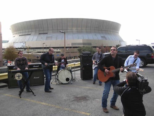 """Pictured L-R are Joe Rogers - keys, Derek George - guitar, Travis Thibodeaux (co-writer of """"The Who Dat Roll"""") - drums, Dave Guidry - bass, Steve Williams – vocals, and Charlie Hutto on guitar."""