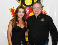 """Wilson made a stop at WTQR in Greensboro recently to promote her """"Work Hard, Play Harder"""" single from her upcoming I Got Your Country Right Here album. Pictured: Wilson (L) WTQR PD John Roberts (R). Photo: Kathy Miller, One Shot Photography"""