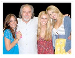 "L-R): Tayla Lynn, Skyville Records partner/producer Paul Worley, Caroline Cutbirth and Jennifer Wayne. The three ladies are collectively known as Stealing Angels. Wayne is the granddaughter of actor John Wayne and Tayla Lynn is Lorretta Lynn's granddaughter. The trio's single is ""He Better Be Dead."""