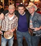 The LoCash Cowboys with show host Adam Richman.