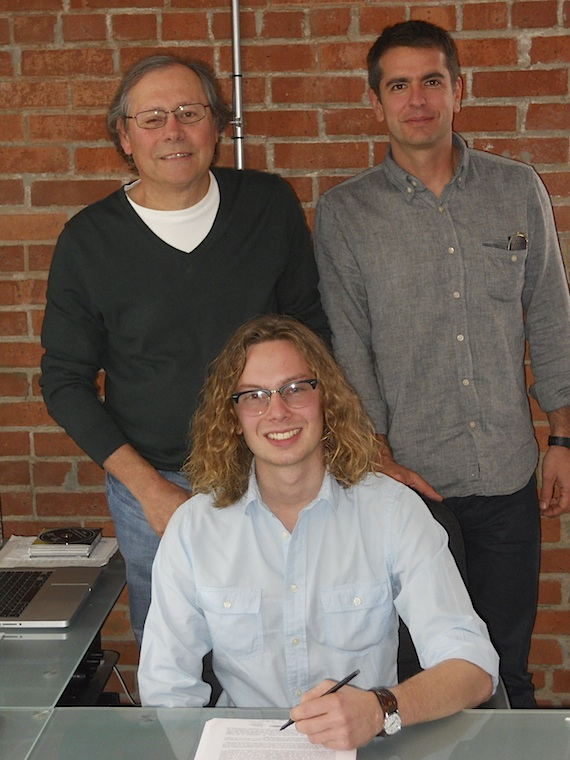 Pictured (L-R): Pat Higdon (Patrick Joseph Music), Jake Mitchell (seated) and Matt Pincus (Songs Music Publishing)