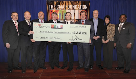 The CMA Foundation donated $1.2 million to benefit music education programs for Nashville's public schools last night at the Schermerhorn Symphony Center. (l-r) CMA Board President, Ed Hardy; CMA Board Chairman, Troy Tomlinson; CMA Chief Executive Officer, Steve Moore; Director of Metropolitan Nashville Public Schools, Dr. Jesse Register; Scotty McCreery; Nashville Mayor Karl Dean; Chevrolet National Promotions Manager, Michael Weidman; Chair of The CMA Foundation Board of Directors, Kitty Moon Emery; and Nashville Public Education Foundation Board Chair, Michael Carter, Sr. Photo credit: Donn Jones/CMA