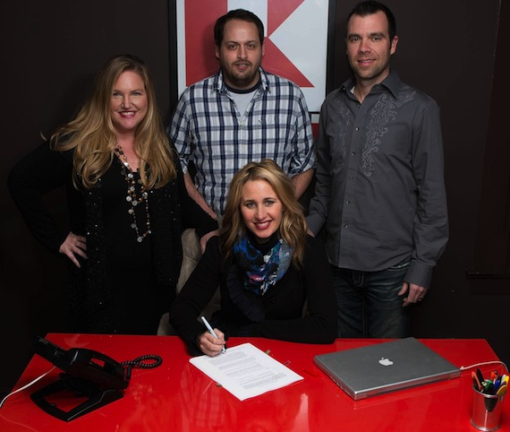 Pictured at the recent signing celebration in Nashville is Jessi Alexander (Seated in Front). Pictured Back Row (L to R): Whitney Daane, Kobalt SVP of Creative; Jeff Skaggs, Kobalt Sr. Director of Creative; and Austen Adams, attorney for Alexander.
