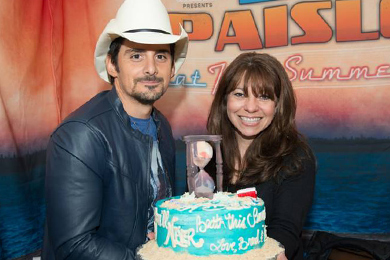 "WKLB – Boston celebrated its 20th Birthday with Brad Paisley and The Henningsen's on the 'Beat This Summer' tour this past weekend where music director, Ginny Rogers was presented with a cake.  (cake say ""Happy 20thBirthday, You'll never Beat This Summer! Love, Brad and The Henningsen's"")"