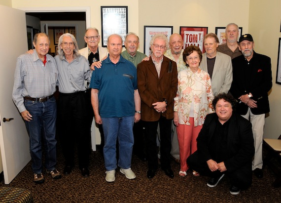 Pictured, left to right, Chip Young, Wayne Moss, Weldon Myrick, Pig Robbins, Jerry Kennedy, Bergen White, Fred Foster, Millie Kirkham, Reggie Young, David Briggs, Ray Stevens and program host Bill Lloyd (front). Photo: Donn Jones