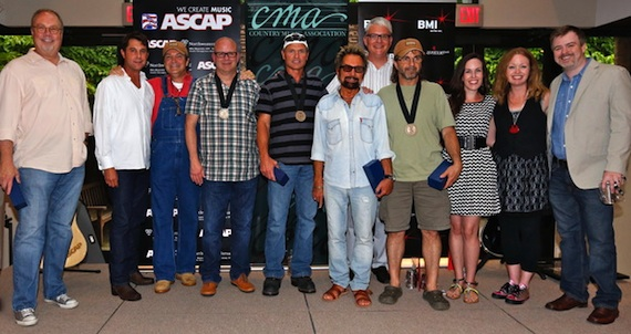 Pictured (L-R): UMG Nashville's Mike Dungan, ASCAP's Michael Martin, HoriPro Entertainment's Butch Baker, co-writers Mark Bright and Tim James, Tony Brown, BMI's Perry Howard, co-writer Phil O'Donnell, Delbert's Boy Music's Kirsten Wines, and Warner/Chappell's Alicia Pruitt and Ben Vaughn. Photo by Ed Rode.