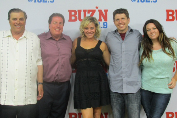 "Flying Island's Gwen Sebastian celebrates her album release and latest single ""Suitcase"" with the staff of KMNB, Minneapolis. Pictured (L-R): Mick Anselmo (Sr. VP), Rob Morris (PD), Gwen, Tommy Jay (APD), and Tricia Jenkins (MD)."