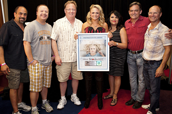 "Miranda Lambert and Sony Music Nashville staffers were all smiles Thursday for the opening night of the four day CMA Music Festival. Backstage at LP Field before her show, SMN CEO/Chairman Gary Overton & staff surprised Lambert with a platinum plaque for ""Mama's Broken Heart."" Pictured (L-R): Paul Barnabee; Josh Easler; Gary Overton; Lambert; Caryl Healey; Wes Vause. Photo: Brian Kaplan"