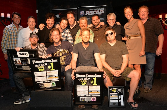 Pictured (L-R): co-writer Chris Tompkins, Florida Georgia Line's Tyler Hubbard and Brian Kelley, and co-writer Rodney Clawson; (back row, l-r): ASCAP's Michael Martin, BMI's Jody Williams, Big Machine Label Group's Scott Borchetta, Big Loud Mountain's Kevin (Chief) Zaruk, producer Joey Moi, Big Loud Shirt's Craig Wiseman and Seth England, Republic Nashville's Jimmy Harnen, BMI's Penny Everhard, and ASCAP's Mike Sistad. Photo by Rick Diamond