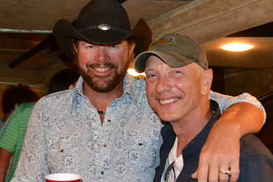 "Toby Keith took his Hammer Down tour to Pittsburgh promoting his latest single ""Drinks After Work"" which takes home the greatest spin increase this week. Pictured with WDSY APD/MD Stoney Richards."