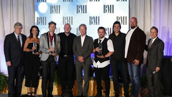 """Building 429 is honored for Song of the Year (""""Where I Belong""""). Pictured are (l-r): BMI's Phil Graham, Provident Music Group's Holly Zabk, Building 429's Jason Roy and Aaron Branch, Provident Music Group's Terry Hemmings, Building 429's Michael Anderson and Jesse Garcia, Provident Music Group's Devon DeVries, and BMI's Jody Williams. Photo: John Russell."""