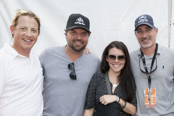 Pictured (L-R): BMI's Clay Bradley, Dallas Davidson, Native Run's Annie Clements and Universal's Steve Hodges gather for a photo backstage at the BMI Tailgate Party outside LP Field during 2013 CMA Music Festival. (Erika Goldring Photo)