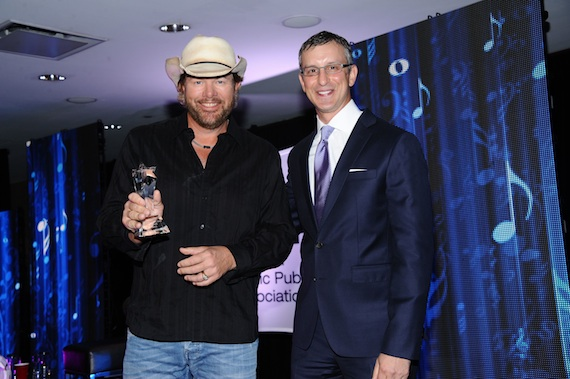 PHOTO CUTLINE: NMPA President and CEO David Israelite presents Toby Keith with the 2013 Songwriter Icon Award