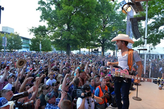 Justin Moore gets an enthusiastic crowd response during his performance at the Brickyard 400.