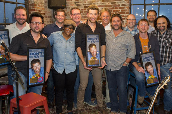 Pictured (L-R) Front: Chris DeStefano (Co-writer/producer), Camille Alston, Brett Eldredge, Chris Stacey (SVP Promotion, WMN), Ashley Gorley (co-writer), Lou Ramirez (Regional Promo Mgr – SW, WMN). Back: Josh Van Valkenburg (Dir. A&R, EMI Music Publishing), Rob Baker (RLB Artist Management), Peter (Strickland (EVP & GM, WMN), Scott Hendricks Sr. VP A&R, WMN),Kevin Herring (VP National Promotion, WMN) and Chad Schultz (National Dir. Radio Interactive Mktg., WMN)