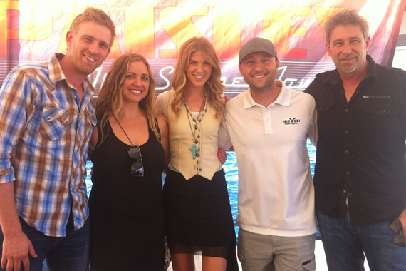 """Arista Nashville's The Henningsens visited with KEGA in promotion of their No 35 single """"I Miss You"""" before playing Salt Lake City last Friday on Brad Paisley's Beat This Summer Tour. Pictured (L-R): Aaron Henningsen, Amanda (KEGA's AM Show), Clara Henningsen, Jon Watkins (KEGA PD), Brian Henningsen"""