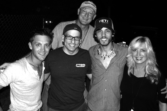 """Bigger Picture Group's Chris Janson recently visited with KMLE about his soon-to-be released single """"Cut Me Some Slack"""" before opening for Dierks Bentley at the annual Country Thunder festival (7/19) in Twin Lakes, WI. Pictured (L-R) Front: Justin Moore, Tim Richards (KMLE PD), Janson, Kelly Lynn Janson. Back: Tim Pohlman (KMLE GM)"""