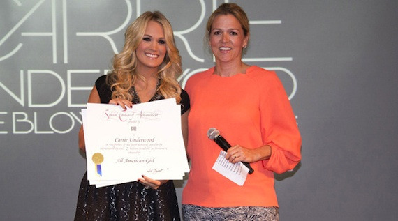 Pictured (L-R): BMI's Associate Director of Writer/Publisher Relations Leslie Roberts with Carrie Underwood. Photo: Chris Hollo