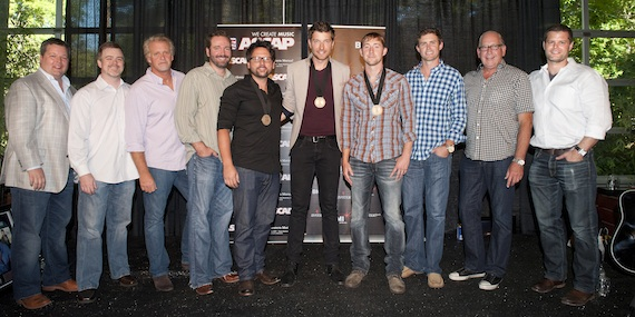 Pictured (L-R): BMI's Bradley Collins, Warner/Chappell Music Publishing's Ben Vaughn, Combustion Music's Chris Farren, Sony/ATV Music Publishing's Josh Van Valkenburg, co-writer Chris DeStefano, Brett Eldredge, co-writer Ashley Gorley, ASCAP's Ryan Beuschel, Warner Music Nashville's John Esposito and RLB Artist Management, LLC's Rob Baker. Photo: Erika Goldring
