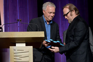 MTSU Mass Communication Dean Ken Paulson presented the Spirit of Americana Freedom of Speech Award to artist Stephen Stills Wednesday night at the association's Honors & Awards show at the Americana Music Festival. The award is given by the association and the First Amendment Center. Photo: Getty Images