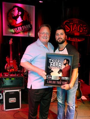"""Pictured (L-R): Sony Music Nashville Chairman and CEO Gary Overton and Columbia Nashville artist Tyler Farr celebrate 5 million views on VEVO for """"Redneck Crazy."""" Photo credit: Alan Poizner"""