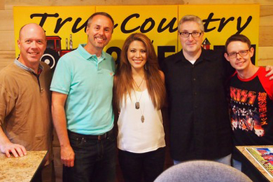 "Sony Music Nashville recording artist Angie Johnson recently performed at WEIO's Barn Bash in promotion of this week's No. 32 single, ""Swagger."" Pictured (L-R): RG Jones, Sony Music Nashville; Kelly Green, WEIO GM; Angie Johnson; WEIO on-air personality Ken Folkes; and Sony Music Nashville's Rusty Sherrill."