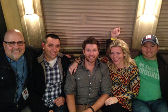 """Brett Eldredge recently visited with WTHT and WPOR before his show in Portland, ME in promotion of his No. 46 Atlantic/WMN single """"Beat Of The."""" Pictured (L-R): Kevin Herring (WMN VP of Promotion), Corey Garrison (WTHT), Eldredge, Katie Bright (WMN) and Matty Jeff (WPOR)."""