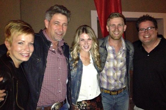 "Arista Nashville's The Henningsens recently visited with Nancy and Newman of WRBT's morning show after performing at BOB FM's concert to fight breast cancer in Harrisburg, PA. The family trio's latest single ""I Miss You"" takes this week's No 16 slot. Pictured (L-R): WRBT's Nancy; Brian, Clara and Aaron Henningsen; WRBT's Newman."