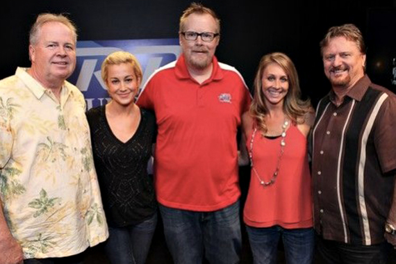 "Kellie Pickler recently stopped by WFUS US 103.5 to promote her latest Black River single ""Little Bit Gypsy"" in anticipation of her Nov. 11 The Woman I Am album release date. Pictured (L-R):  Mike Wilson (Black River); Pickler; Travis Daily (PD); Launa Phillips (MD); and Joe Carroll (Black River)."