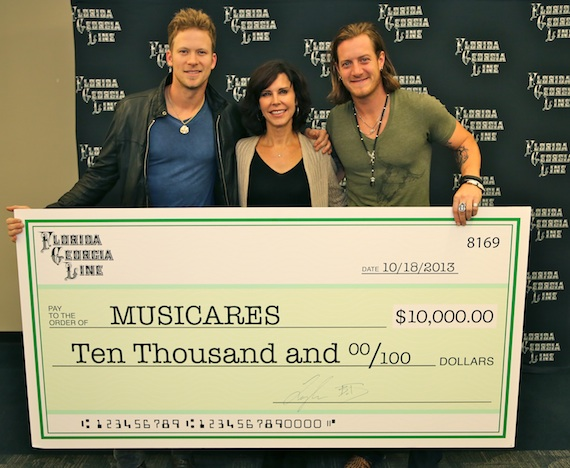 Pictured (L-R): FGL's Brian Kelley; Executive Director of MusiCares Debbie Carroll, LCSW; FGL's Tyler Hubbard. Photo: Justin Mrusek